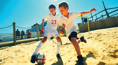 Boys playing beach sports